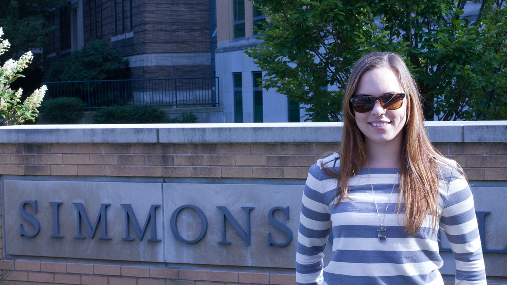 Jordan Tillery in front of the College of Nursing and Health Sciences at Simmons College