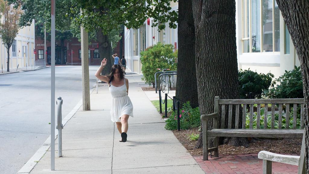 Caitlin Bawn skips down a sidewalk in Boston, Mass.