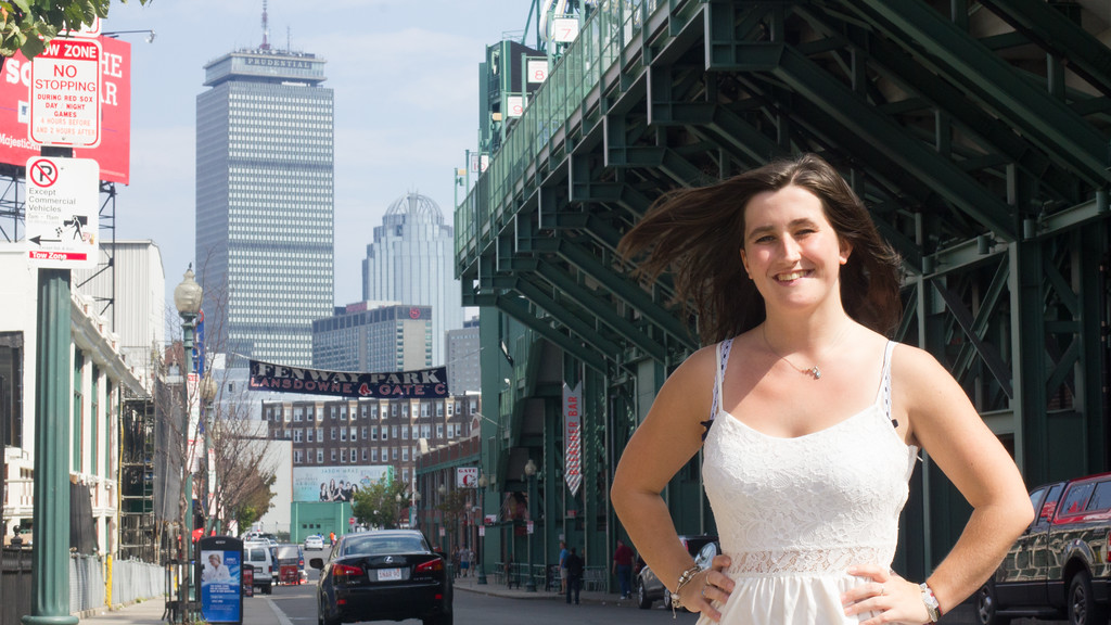 Caitlin Bawn poses next to Fenway park in Boston, Mass