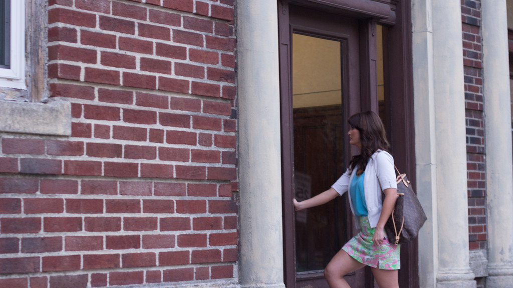 Hayley Crombleholme walks into her apartment building in Brookline. Boston, MA. September 9, 2014. JO 502