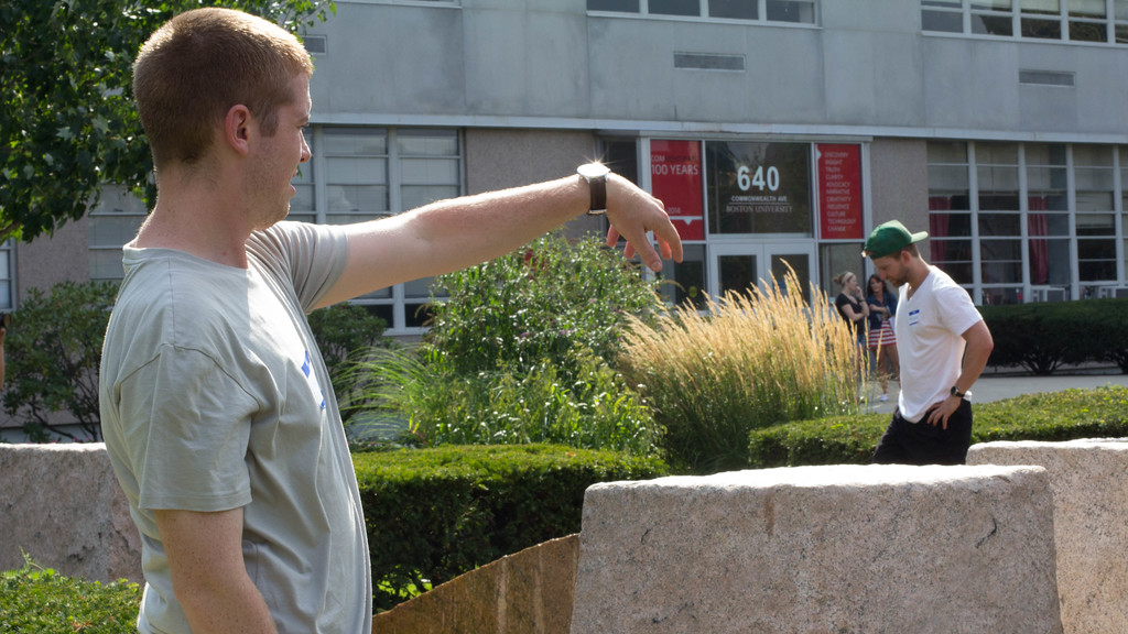 September 6, 2014. Pat O'Rourke, journalism grad student at Boston University, throws a rock outside the COM building in Boston, MA.