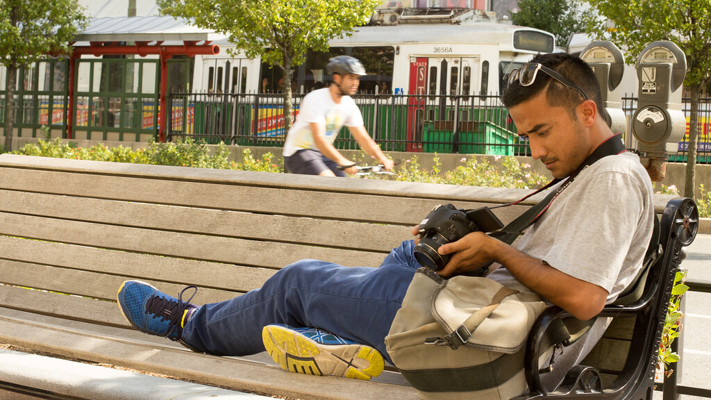 Pankay Khalda, photojournalism graduate student, flips through his pictures for the day outside of Boston University's Law Building on September 6, 2014.