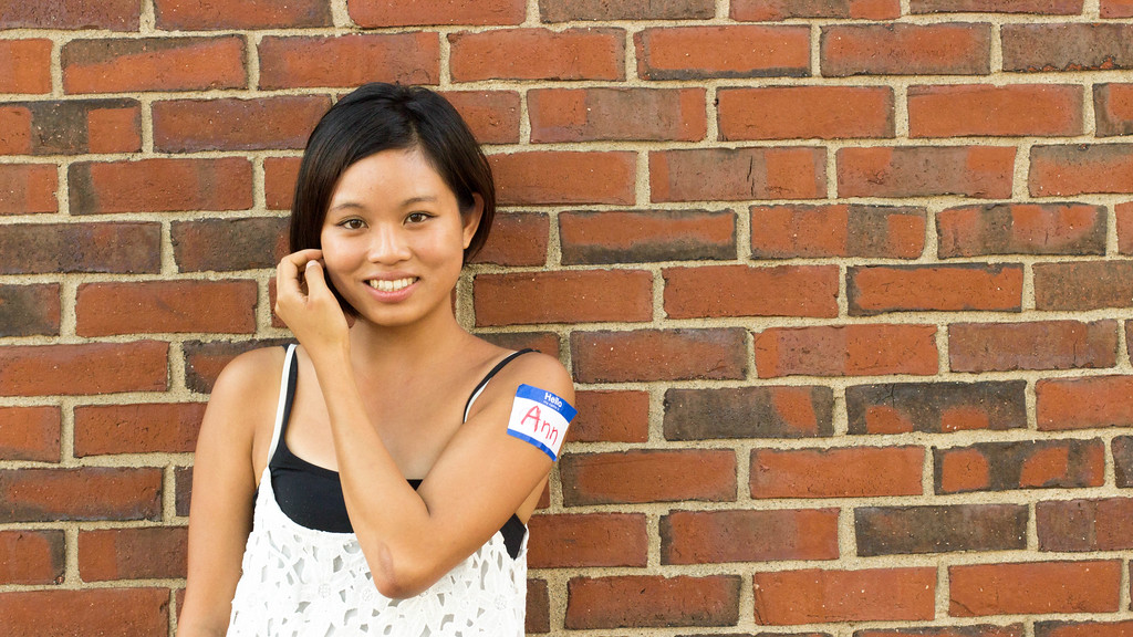 September 6, 2014, Ann Wang, a Boston University graduate photojournalism student, poses in front of a brick wall near the BU College of Communication in Boston, MA for a class exercise