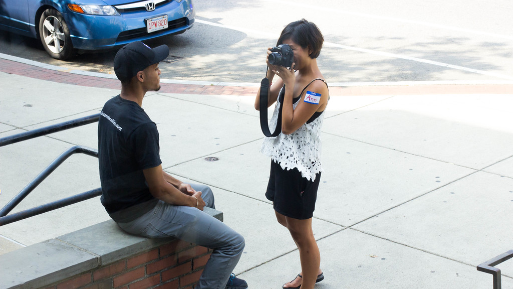 September 6, 2014, Ann Wang, a Boston University graduate photojournalism student, photographs a good sport on Commonwealth Ave. in Boston, MA for a class exercise
