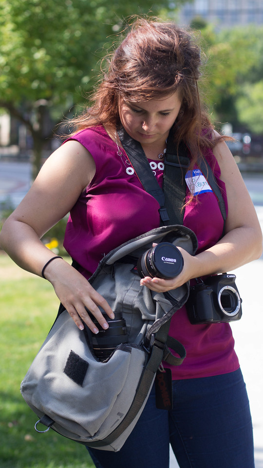 Lauren Westberg switches her camera lenses for a photo shoot on Commonwealth Avenue during a class project on Saturday.