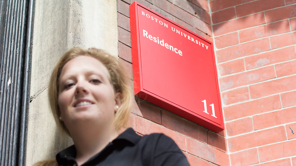 Katie Peverado, journalism graduate student at Boston University, poses for a photo outside her apartment.