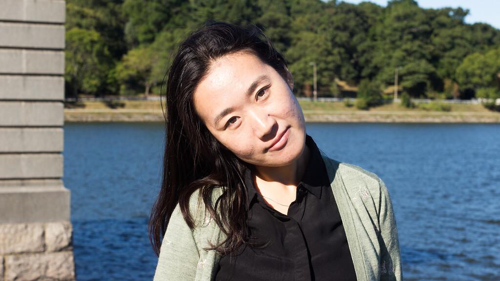 Yanshu Li poses infront of the Chestnut Hill Reservoir on Sept. 12