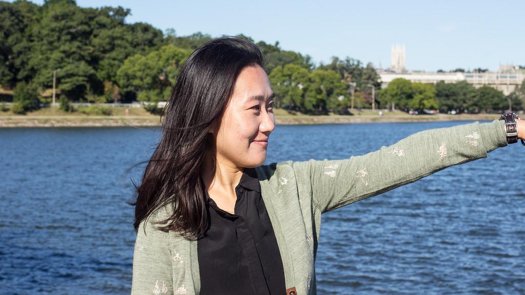 Yanshu Li points to the runners at Chestnut Hill Reservoir on Sept. 12