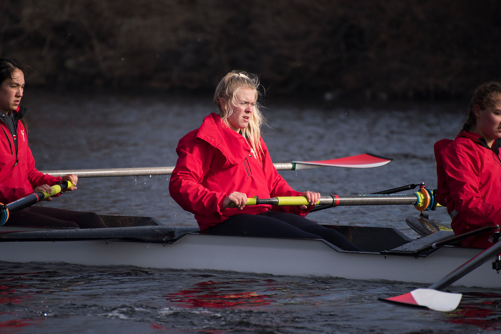 """Anna Weis, a member of the Boston University Women's Rowing Team, rows during a cool down exercise on the Charles River Wednesday morning. This is a segment from the """"24 hours, two bridges"""" project."""