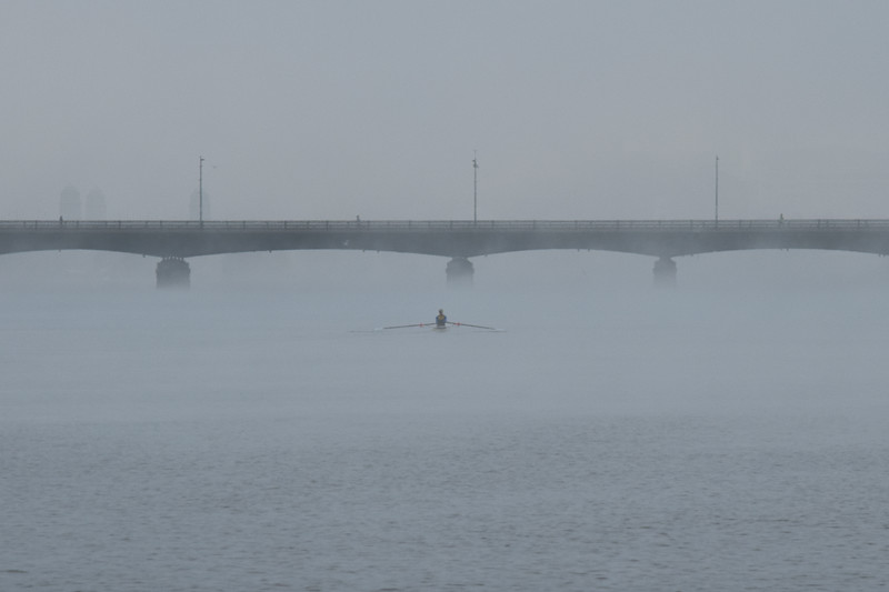"Scenes from the Esplanade on the 11th of April. This is a segment from the ""24 hours, two bridges"" project. Crewman rows the Charles through the morning fog."