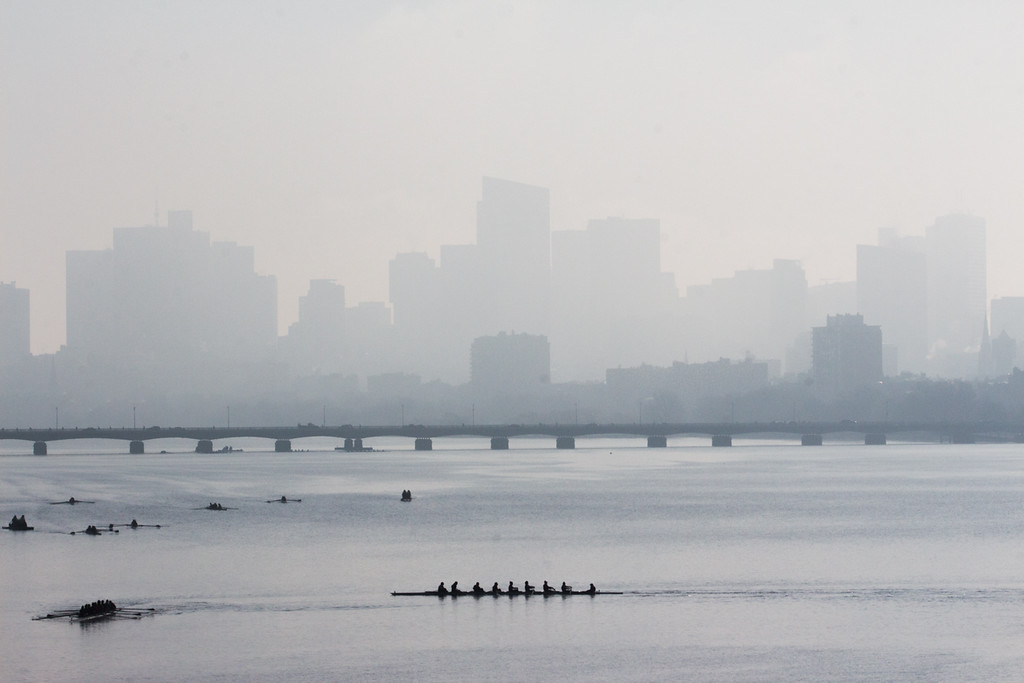 """Rowers dot the Charles River during practice on April 11. This image is part of  the 24-hour project """"Between the Bridges."""""""