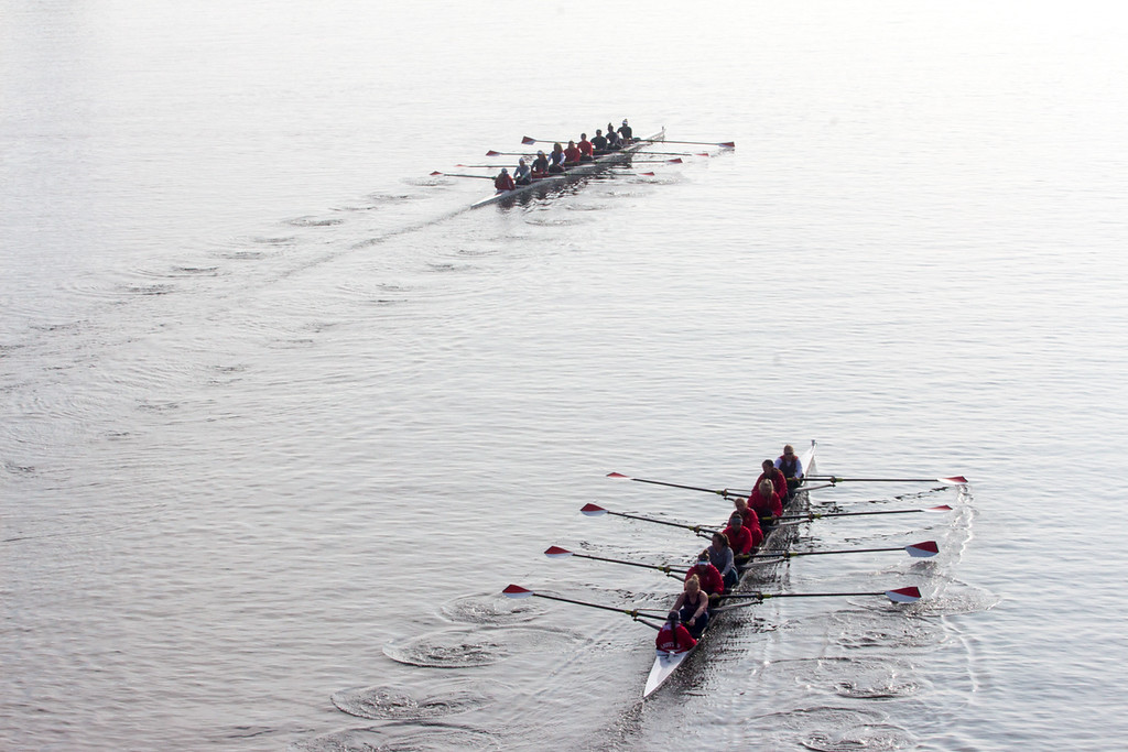 """Rowing boats pass each other on the Charles River during practice in the morning on April 11. This is a segment from the """"Between the Bridges"""" 24 hour project. Photo by: Lauren Fogelström"""