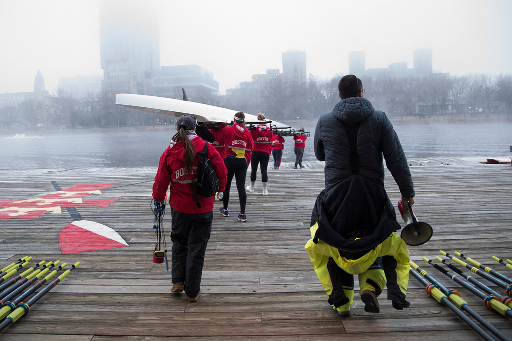 """The Boston University Women's Rowing Team gets ready for a foggy morning practice on Wednesday. This is a segment from the """"24 hours, two bridges"""" project."""