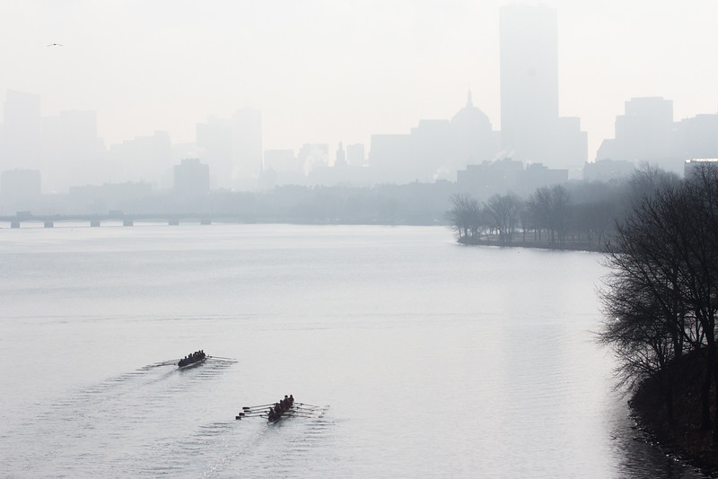"Rowers dot the Charles River during practice on April 11. This image is part of  the 24-hour project ""Between the Bridges."""