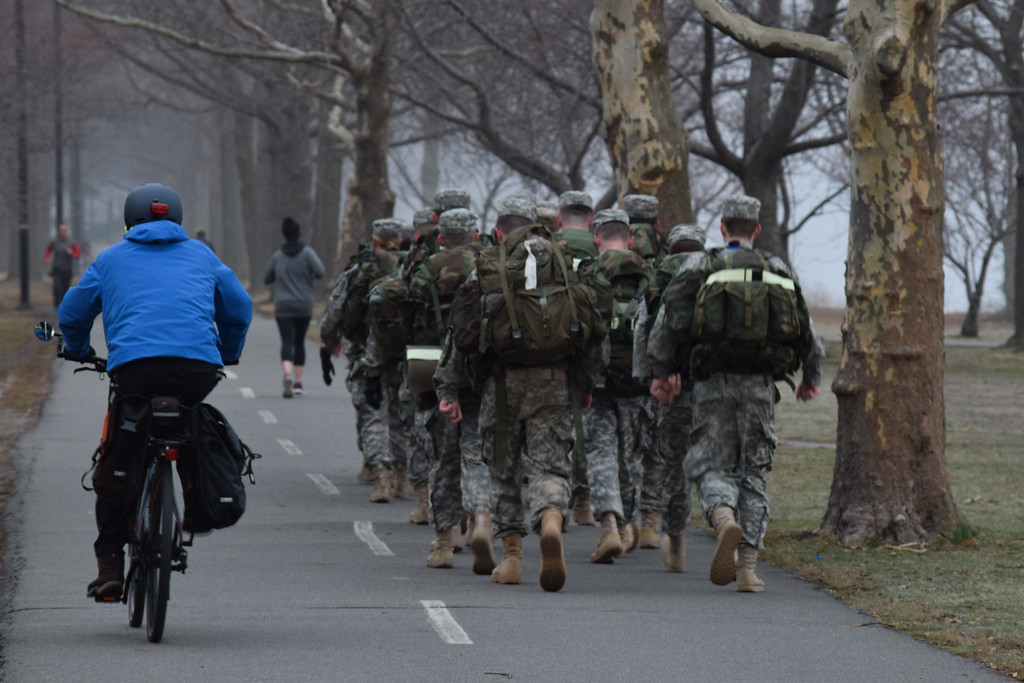 """Scenes from the Esplanade on the 11th of April. This is a segment from the """"24 hours, two bridges"""" project. ROTC marches with weighted packs on the Charles River bike path."""