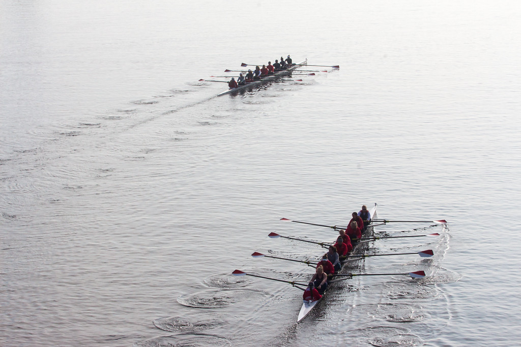 """Rowing boats pass each other on the Charles River during practice in the morning on April 11. This is a segment from the """"Between the Bridges"""" 24 hour project."""