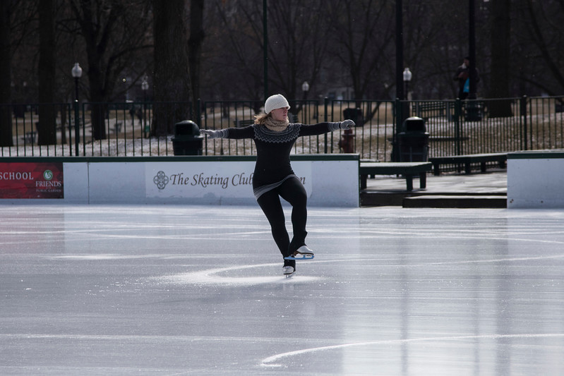 A woman skates on the Frog Pond in Boston Common following a brief snowfall February 6.