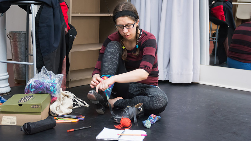 Jo Troll reviews their notes while putting on Irish step shoes during their rehearsal at the Dance Complex in Central Square, April 11.