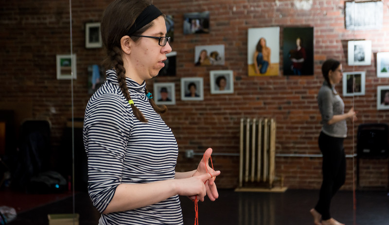 Jo Troll practices finger weaving during their open rehearsal on April 12. Troll's performance combines contemporary Irish step dance with finger weaving and spoken word.