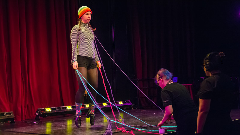 Jo Troll rehearses practices the clogging for their piece while and Katrina Sistare (left) and Kay Coughlin rig a microphone during the tech rehearsal for Femmeshow at OBERON theatre in Harvard Square, April 19.