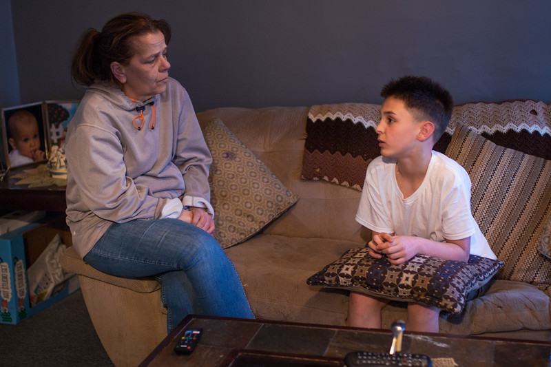 "After dinner,  Jimmy and Judi talk about how it feels to show kindness to those who have less than them. Jimmy said he tries to help others, after being bullied a lot at school until he stood up for himself. ""I think the best part is how thankful they are,"" he said. They chat in their living room in Somerville on April 19."