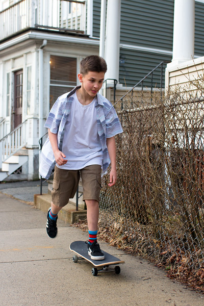 Jimmy skates up and down the block outside his house in Somerville on April 19.