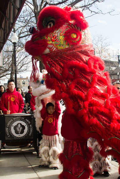 Performers from Calvin Chin's Marshall Arts Academy perform a Lion Dance at Le's Vietnamese Cuisine in Allston, Massachusetts. The dance is done as a celebration of the Lunar New Year to chase away bad spirits.