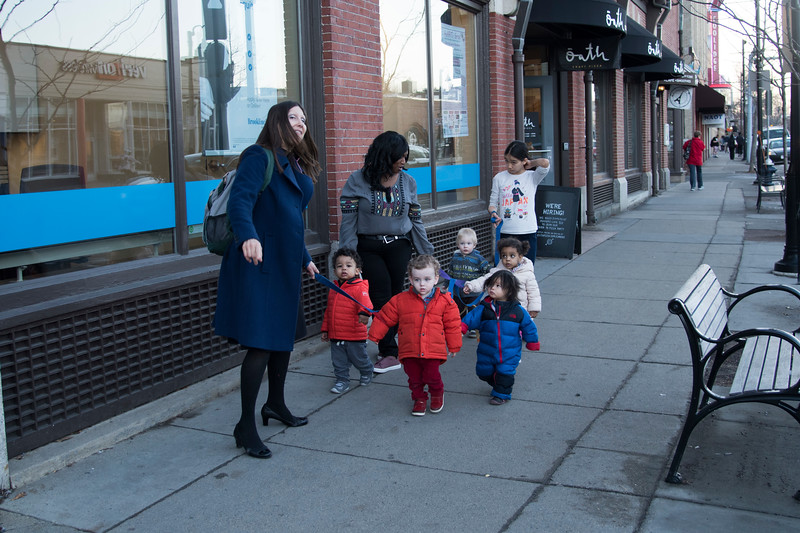 Children of the Sunshine Academy Preschool take a walk around Coolidge Corner under the careful watch and guidance of their chaperones.