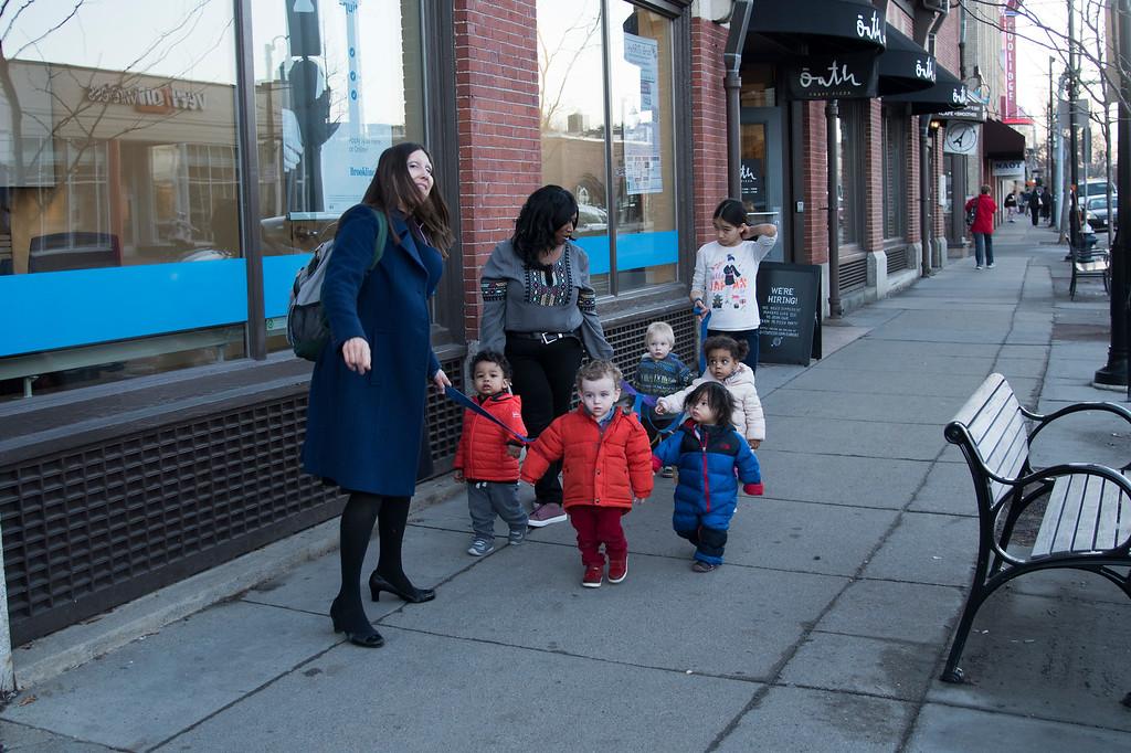 Children of the Sunshine Academy Preschool take a walk around Coolidge Corner under the careful watch and guidance of their chaperones.