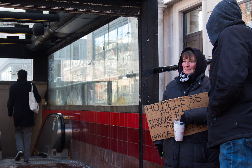 Susan Jones, 51, begs for change outside Harvard Square MBTA station, on Feb. 18. As a homeless mother of two teenage sons , she said the money she collects helps to support the boys, who currently attend public high school and spend nights in a house for homeless youth.