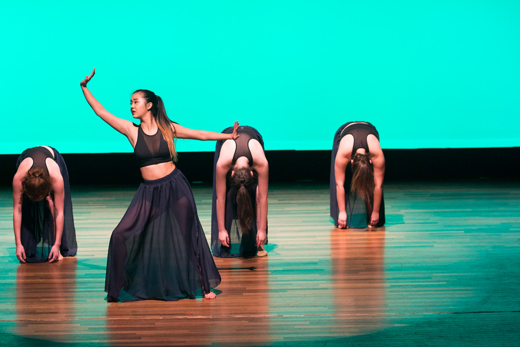 """Student Lucy Yang, of the Boston University Edge team is spotlighted during the group's dance titled """"Tear,"""" at the Tsai Performance Center in Boston, on Feb. 24."""