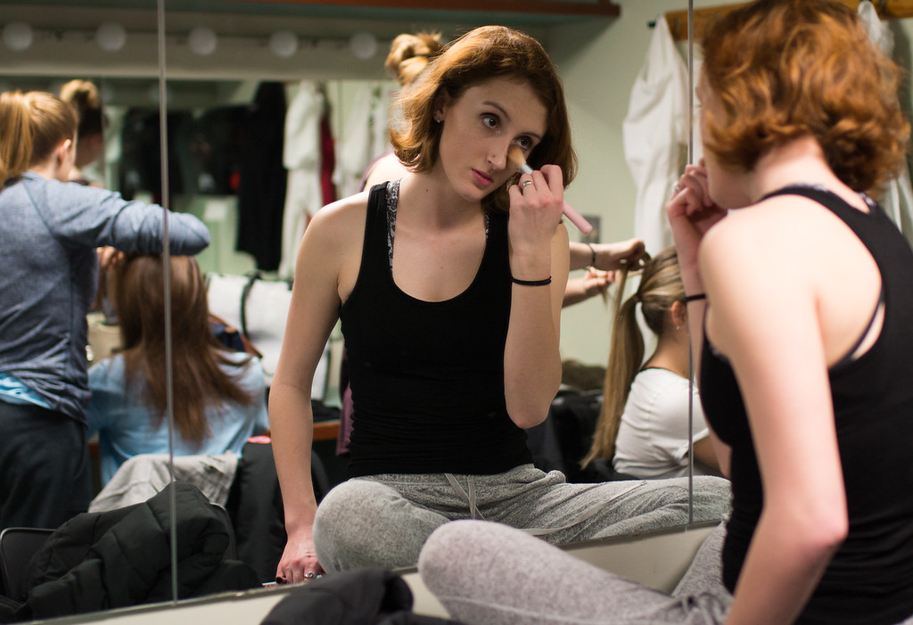 Student Madison Frilot, of the Boston University Edge dance team, touches up her make-up before their show at the Tsai Performance Center in Boston, on Feb. 24.