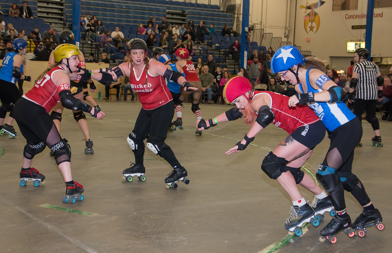 Wicked Pissah's Sweet Enemy pushes FeistE of the Cosmonaughties out of bounds during Boston Roller Derby's home bout.