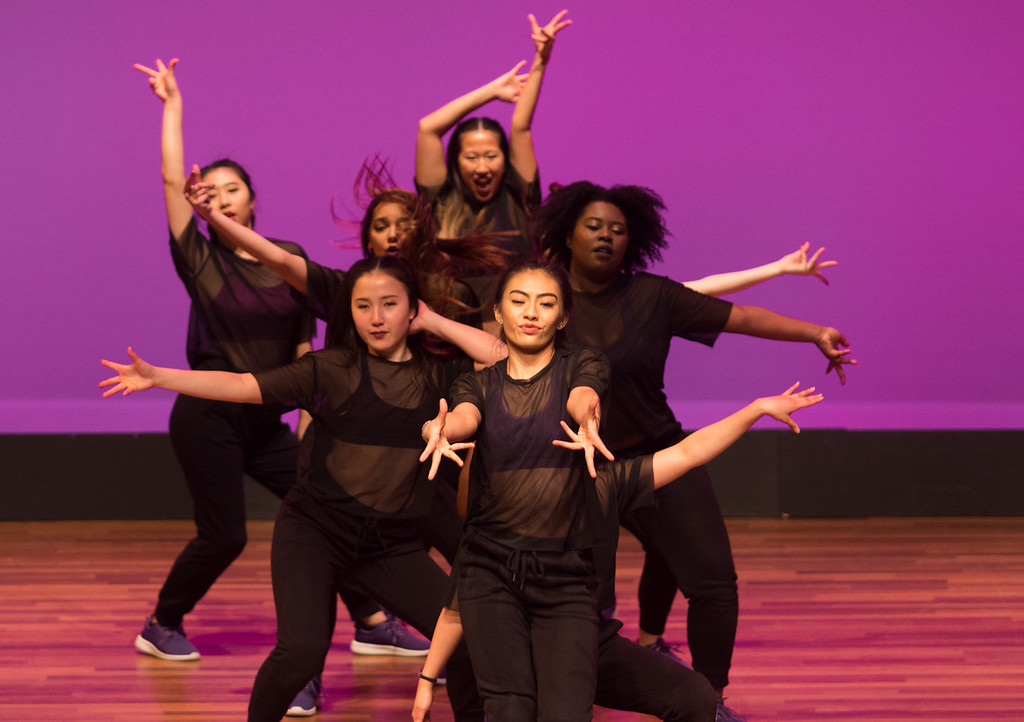 Student Amy Rivera, of the Boston University Vibes all-female hip-hop team, leads her group through a section of their dance at the Tsai Performance Center in Boston, on Feb. 24.