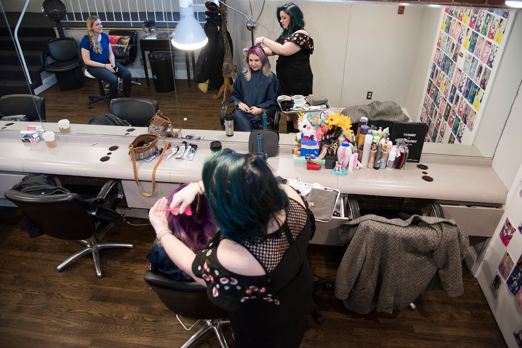 Stephanie Geib, a hair dye specialist at Dellaria Salon, paints dye onto her client Sarah Lodato's hair. Geib, who has over 45k followers on instagram, is known for her vivid hairstyles and expert balayage. At this appointment, Lodato gets a touch-up on her purple, blue, and green-pastel hair.