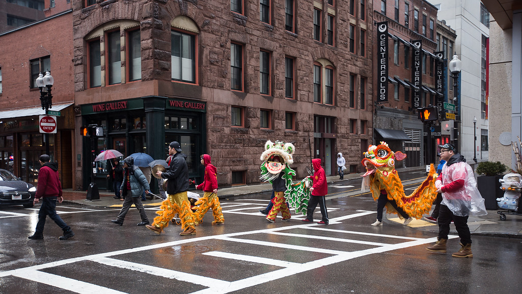 Dragon and LIon Dance Parade in Chinatown.  As one of  the Chinese traditions to celebrate Chinese New Year, dancers dressed in dragon and lion costums would visit door to door for good luck and harvesting.
