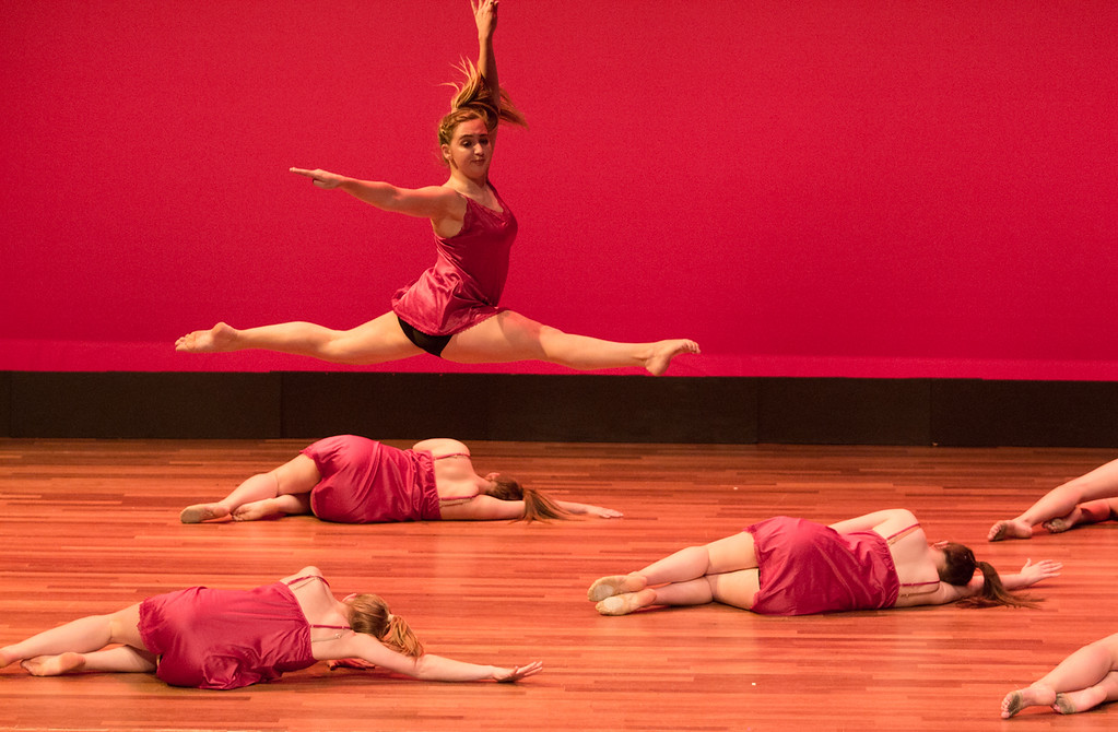 """Dancer Emma Bolduc, of the Boston University Edge dance team, leaps during the group's dance titled """"Fall for You,"""" at the Tsai Performance Center in Boston, on Feb. 24."""