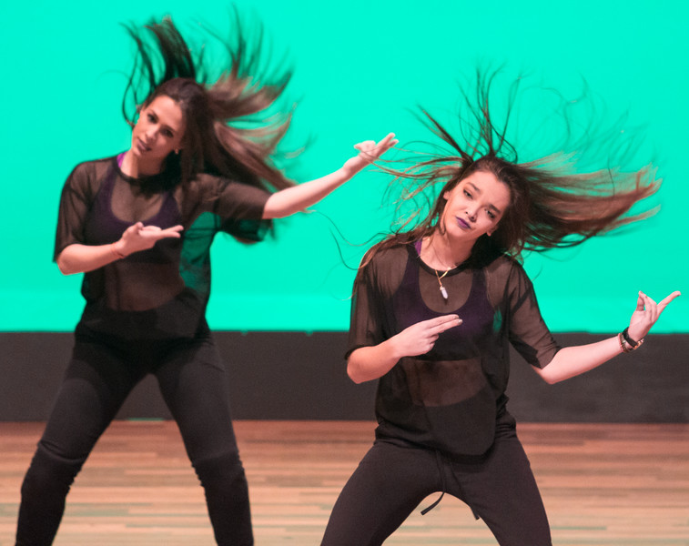 Dancer Gabi Cosi, of the Boston University Vibes all-female hip-hop  team, performs during their dance at the Tsai Performance Center in Boston, on Feb. 24.