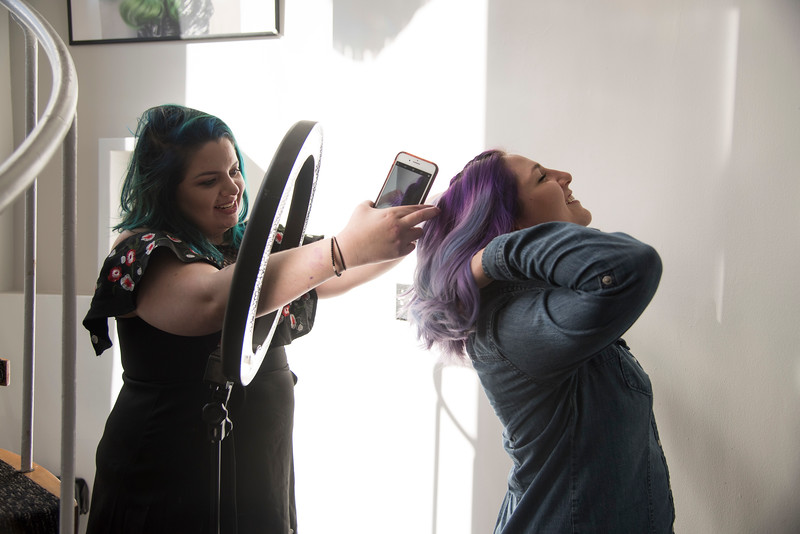 Stephanie Geib, a hair dye specialist at Dellaria Salon on Commonwealth Ave., poses client Sarah Lodato so she can get the perfect picture for her Instagram, @Steph.Scissorhands. Geib, who has 45k followers on instagram, is known for her vivid hairstyles, and often uses clients as models for her Instagram photos.