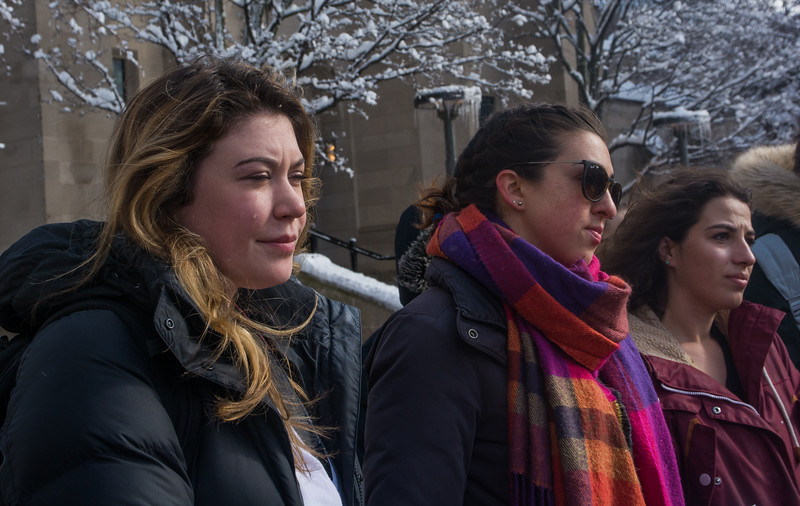 Jackie O'Brien, Lindsay Fuori, and Annie Zaruba-Walker (L-R) listen as the names of the Parkland shooting victims are read during the Walkout for Action demonstration at Boston University's Marsh Plaza on March 14.