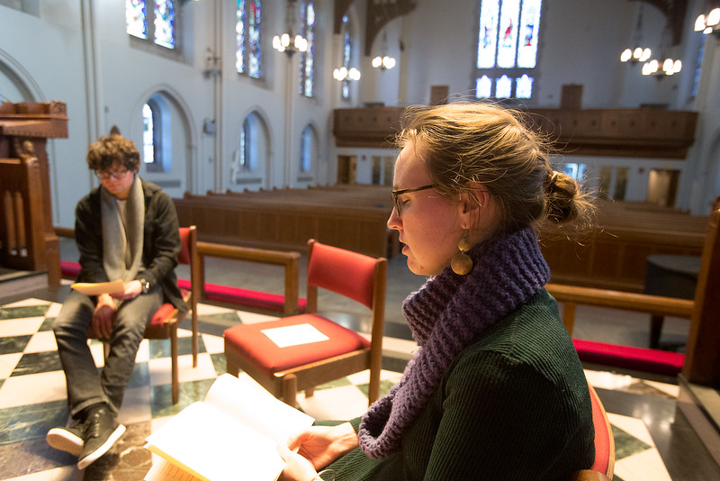 Liz Marshal, graduate student studying theology, is leading the quiet moment after singing and reading of the night prayer at Marsh Chapel.