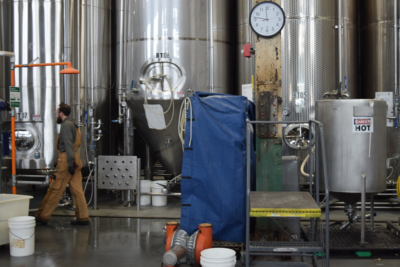 Andrew Oratovski inspects the fermentation tanks at Downeast cider house.