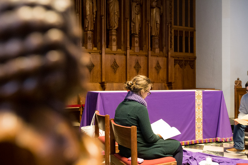 Liz Marshal, graduate student studying theology, is leading the singing and reading of the night prayer at Marsh Chapel.