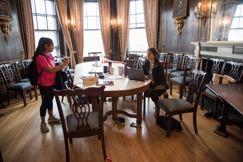 Erica Moreira (right), a Junior at Boston University, studies and talks to fellow housemate Nikita Limaye in the dining room of the Harriet E. Richards--or HER--house, a women's cooperative residence hall at Boston University.