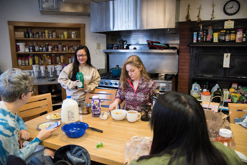 HER House residents Clair Tran and Caitlin O'Rowche hang out in the shared kitchen of the women's cooperative residence hall at Boston University. All 24 residents cook meals and eat in this space, and have house dinners here every night Sunday through Thursday.