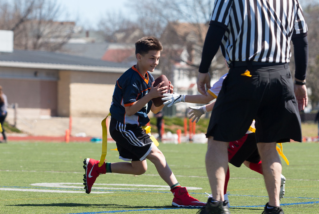 Jimmy makes a run during his team's football game at Dilboy Field in Somerville on April 22.