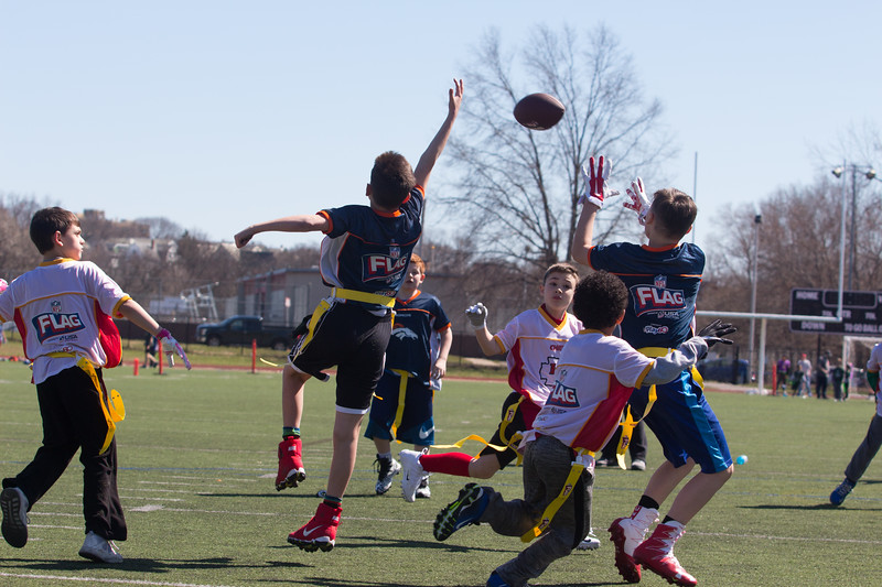 Jimmy tries to deflect a pass during his flag football game at Dilboy Field in Somerville on April 22.