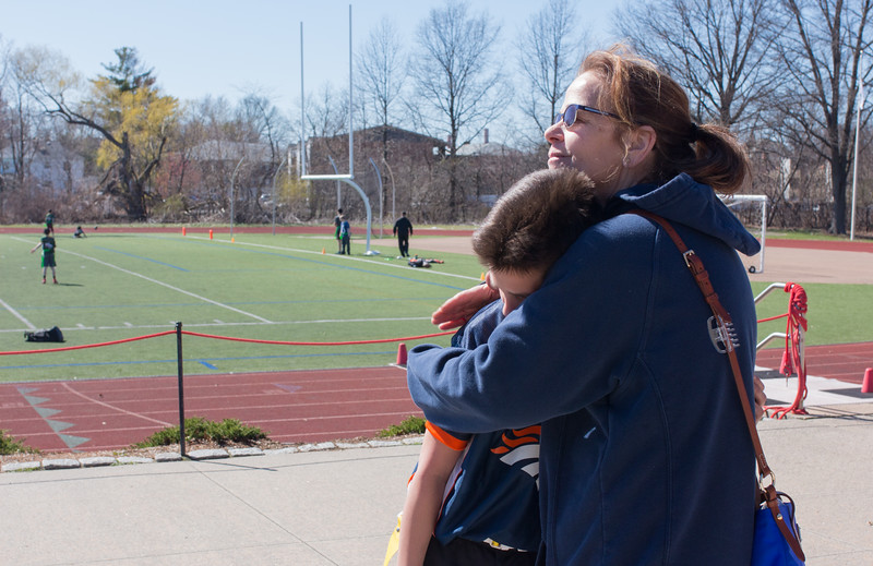 Judi hugs Jimmy after his flag football game at Dilboy Field in Somerville on April 22.