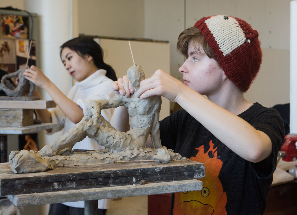 Daria Lugina (right)  and Zhiying Cai work on sculptures during a studio class at Boston University's College of Fine Arts.
