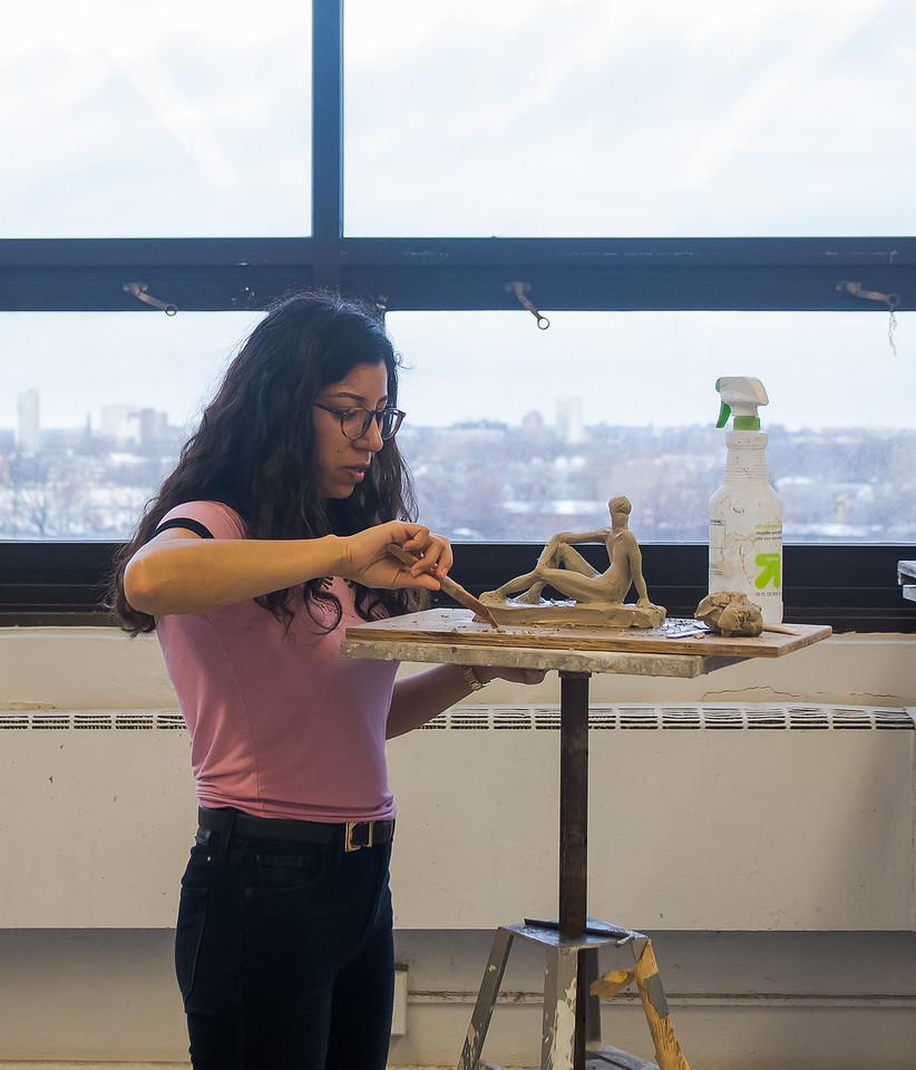 Evelyn Castro works on her sculpture during a studio class at Boston University's College of Fine Arts.